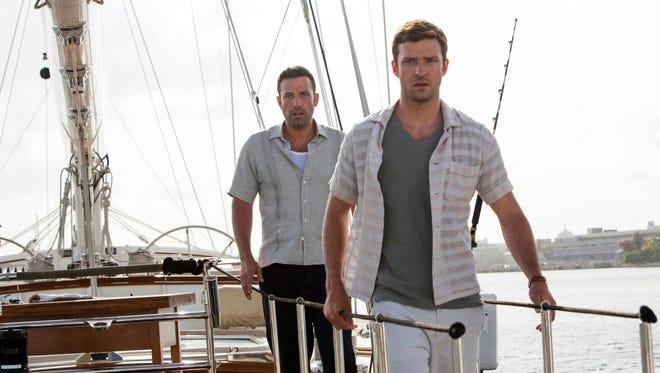 Justin Timberlake, front, and Ben Affleck star in the new crime thriller 'Runner, Runner.'