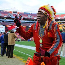 Washington Redskins fan Chief Zee on the field before a 2013 NFC Wild Card playoff game his favorite team played against the Seattle Seahawks at FedEx Field. Three U.S. senators have introduced legislation that would strip the NFL of its tax-exempt status unless the Washington franchise changes its name from Redskins, which is defined in the dictionary as a racial slur.