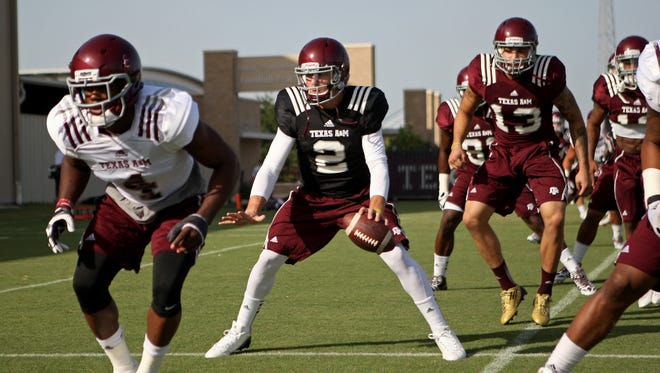 Texas A&M quarterback Johnny Manziel (2) and teammates practice at Coolidge Field on Aug. 7. The Aggies will hold an open practice at Kyle Field on Saturday night, but the school is limiting the items that fans can have signed by players and coaches.