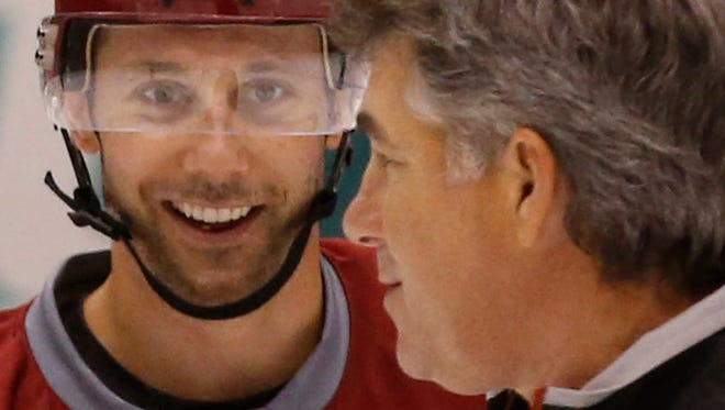Coyotes' forward Sam Gagner talks with head coach Dave Tippett during Veterans Camp at Gila River Arena in Glendale on Sept. 20, 2014.