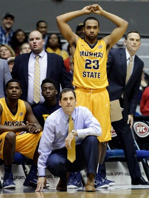 Murray State coach Steve Prohm and guard Justin Seymour (23) watch late in the second half of an NCAA college basketball game against Belmont in the final of the Ohio Valley Conference tournament Saturday, March 7, 2015, in Nashville, Tenn. Belmont won 88-87. (AP Photo/Mark Humphrey)