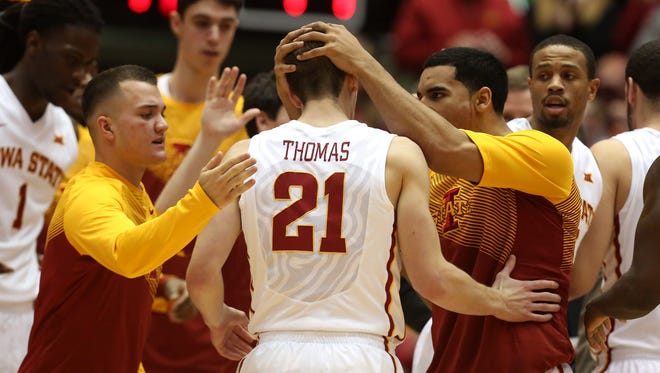 Members of the Iowa State basketball team celebrate as sophomore Matt Thomas returns to the bench after hitting a 3-point field goal against Oklahoma State on Tuesday. Thomas finished the game with 10 points.