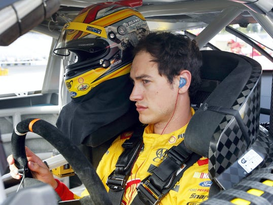 Joey Logano sits in his car as he waits for qualifying to begin for Sunday's NASCAR Sprint Cup series 5-hour Energy 301 auto race at New Hampshire Motor Speedway on Friday in Loudon, N.H.