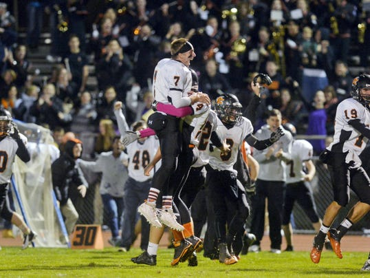 York Suburban quarterback Thomas Merkle (7) celebrates with teammates after kicker Jonas Atkinson kicked a game-winning field goal at West York. After trailing for the entire game, York Suburban defeated West York, 23-22.