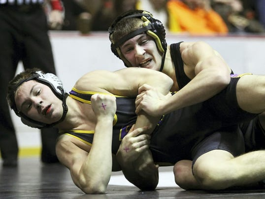 Biglerville's Nate Newberry takes control of Boiling Springs' AJ Kostyak during their 145 pound match in the District 3 Class AA finals at Hersheypark Arena on Saturday. Newberry won title, and now sports a 31-2 record this year. He hasn't lost a match in more than a month.