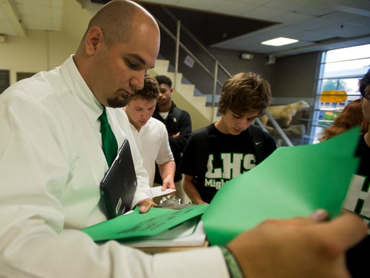 Lafayette High Principal Donald Thornton helps students with their class schedules on the first day of school in August 2015. Thornton is going into his second year as te school's principal.