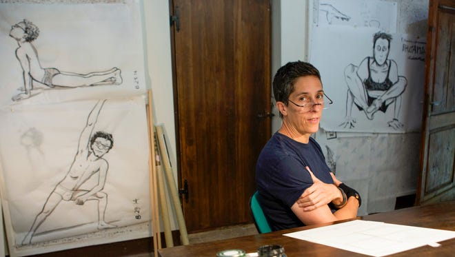 U.S. cartoonist Alison Bechdel portrayed as she works in her studio at the castle of Civitella Ranieri, central Italy, Sept. 2.