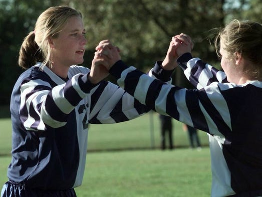 Mercy senior Abby Wambach celebrates with a teammate after she scored her second goal of the game during the Aquinas/Mercy game at Mercy on Ocy. 17, 1997