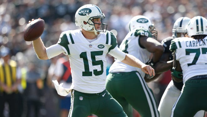 Jets quarterback Josh McCown prepares to throw a pass against the Oakland Raiders in the third quarter at Oakland Coliseum.