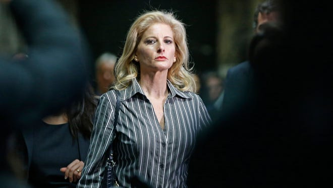 "FILE - In this Dec. 5, 2017 file photo, Summer Zervos leaves Manhattan Supreme Court at the conclusion of a hearing in New York. Lawyers for President Donald Trump and Zervos, a former ""Apprentice"" contestant who sued the president for saying her sexual misconduct claims were lies, are scheduled to be in court Tuesday, June 5, 2018, in New York. (AP Photo/Kathy Willens, File) ORG XMIT: NYHK102"