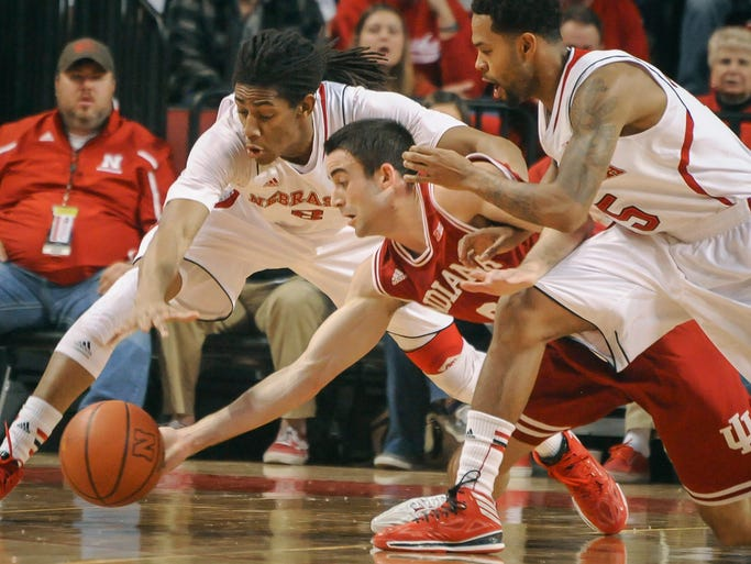 Nebraska forward David Rivers (2) and  guard/forward Terran Petteway (5) battle Indiana  forward Will Sheehey (0) for a loose ball during an NCAA college basketball game, Thursday, Jan. 30, 2014 in Lincoln, Neb.(AP Photo/Dave Weaver)