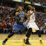 Indiana Fever forward Tamika Catchings (24) battles for rebounding position against Minnesota Lynx forward Maya Moore (23) during Sunday's Game 4 of the WNBA Finals at Bankers Life Fieldhouse in Indianapolis. Indiana won 75-69.