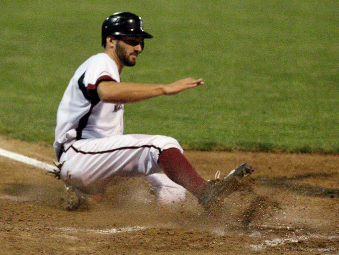 Sheboygan A's Cole Heili (41) slides into home plate against Menasha Friday August 15, 2014 in Sheboygan.