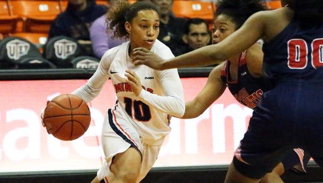 UTEP guard Faith Cook, 10, moves the ball around the floor against Florida Atlantic Thursday night.