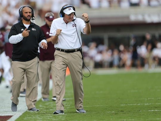 MSU head football coach Dan Mullen celebrates after Mississippi State's Nick Fitzgerald (7) scored on the first series of the game. Mississippi State played Charleston Southern in a college football game on Saturday, September 2, 2017 at Davis Wade Stadium in Starkville.