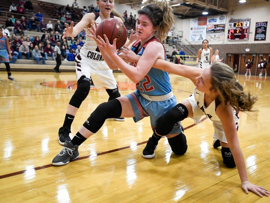 Henderson's Alyssa Dickson (15) and Henderson's Emilee Hope (30) trap Union County's Jralee Roberson (22) in the corner as the Henderson County Lady Colonels play district rival the Union County Braves at Colonel Gym Monday, January 22, 2018.