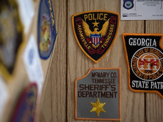 A patch from the Adamsville Police is seen among police patch from all over the world Thursday, March 8, 2018, at the Buford Pusser Home & Museum in Adamsville.