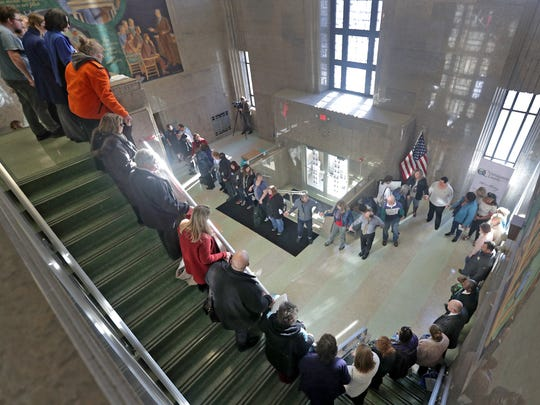 Supporters and advocates hold hands on Wednesday afternoon in the main entrance to the Outagamie County administration building in Appleton during the Hands Around the Courthouse event.