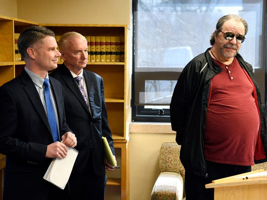 FILE - In this Thursday, April 19, 2018 file photo, Freddie Joe Lawrence, right, one of two men whose convictions were overturned for a 1994 murder, speaks at a press conference with Montana Innocence Project attorneys Toby Cook, left, and Larry Jent in Missoula, Mont.