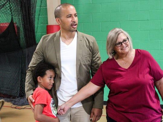 Kim Glover, right, introduces her grandson, Benjamin