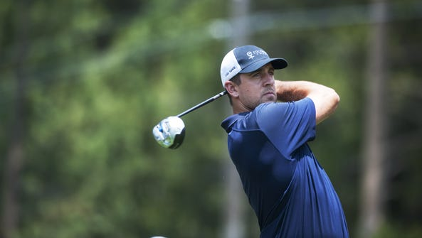 Packers quarterback Aaron Rodgers competes at the American