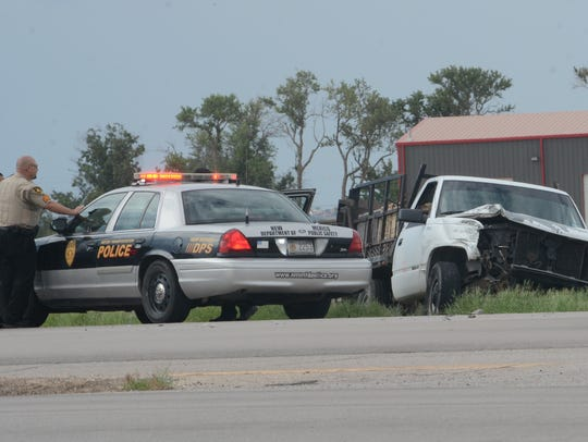 Eddy County Sheriff's Officers at the scene of a traffic