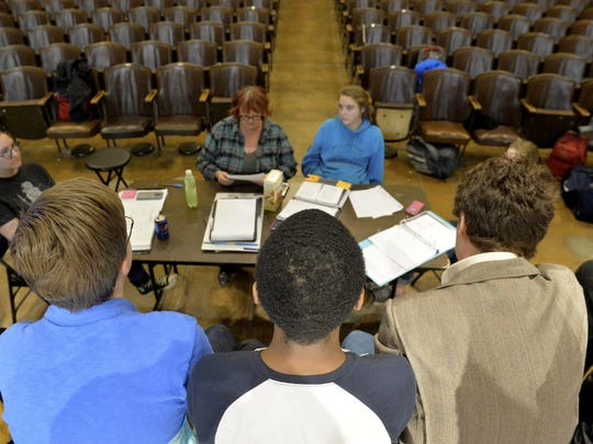 """The cast of Great Falls High's """"To Kill A Mockingbird"""" meet with performing arts teacher Krystina Thiel during Tuesday's rehearsal. The play led to a schoolwide discussion on racism and injustice."""