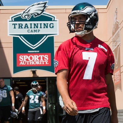 Eagles quarterback Sam Bradford walks onto the field for the first day of training camp on Sunday.