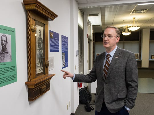 Christopher Harrington, Interim Dean, School of Education, Social Science and The Arts at UMES, talks about his exhibition at Salisbury Art Space feature Negro League memorabilia and artwork on Friday, Feb. 23, 2018.