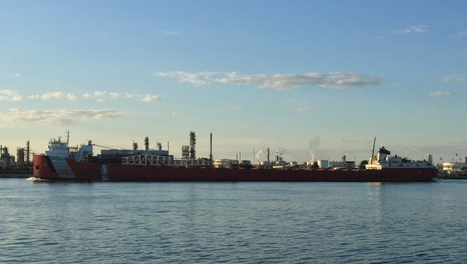 The John G. Munson heads up the St. Clair River under sunny skies.