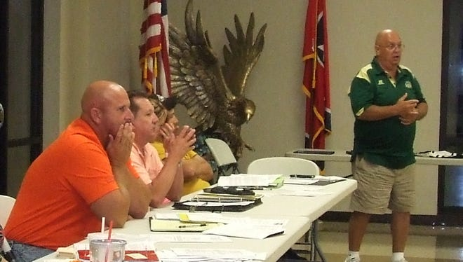 Tommy Shelton, right, District Director of Little League, addresses board members and guests at the Sept. 1 Athletic Association of Stewart County meeting. Also pictured, from left, are board members Eric Milliken, John Elliott, Tammy Maria and Josh Sanford.