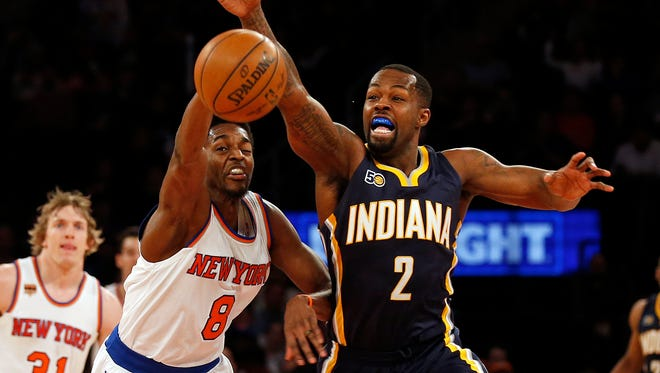 Indiana Pacers guard Rodney Stuckey (2) and New York Knicks guard Justin Holiday battle for a loose ball March 14, 2017.