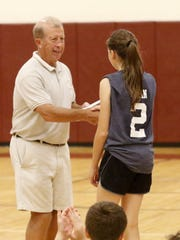 Bill Hopkins hands out an award during the final day of the Finger Lakes Boys & Girls Basketball Camp presented by the Shoot the Lights Out Basketball Academy on July 13, 2017 at Odessa-Montour High School.