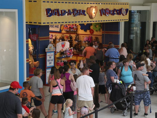 Shoppers line up outside the Build-A-Bear Workshop