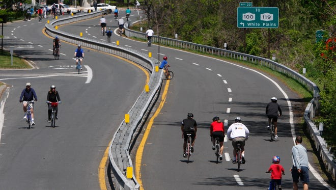 Cyclists enjoy Bicycle Sunday on the Bronx River Parkway in White Plains. The Westchester County recreation event takes place on Sundays in May, June and September, except Memorial Day weekend and runs from 10:00 a.m.until 2:00 p.m..  The parkway is closed to vehicular traffic during this time, from Scarsdale Road in Yonkers to the Westchester County Center in White Plains.