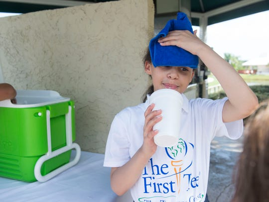Maggie Ellis, 9, Hobe Sound, cools off with a cold