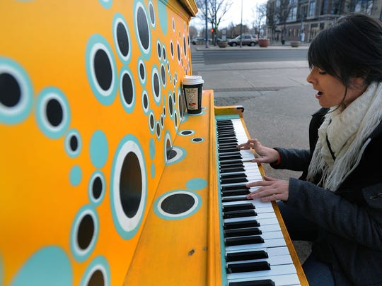 Melody Kloefkorn sings and plays her original music at a polka-dotted piano in the Oak Street Plaza in downtown Fort Collins in 2012.