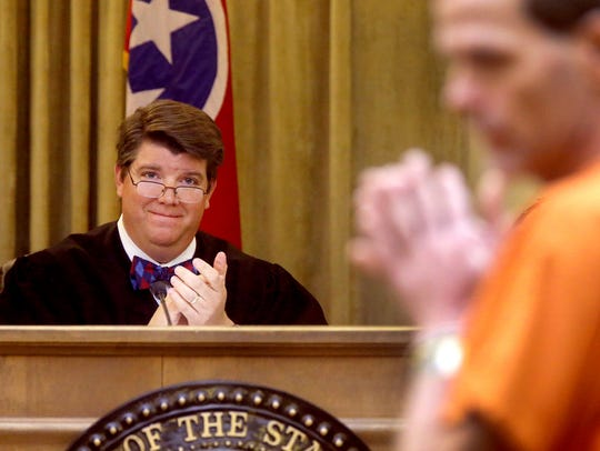 Judge Barry Tidwell applauds as a man is approved to go through the Mental Health Court program in 2017.
