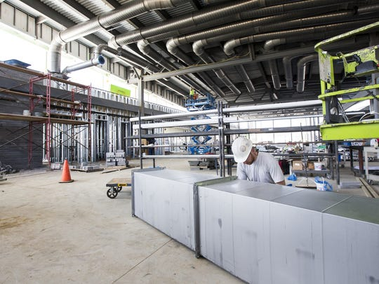 Workers continue construction on the new library off of Route 9 in New Castle last week.