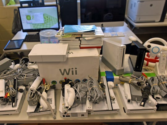 Nintendo Wii game consoles are on a table at Chambersburg