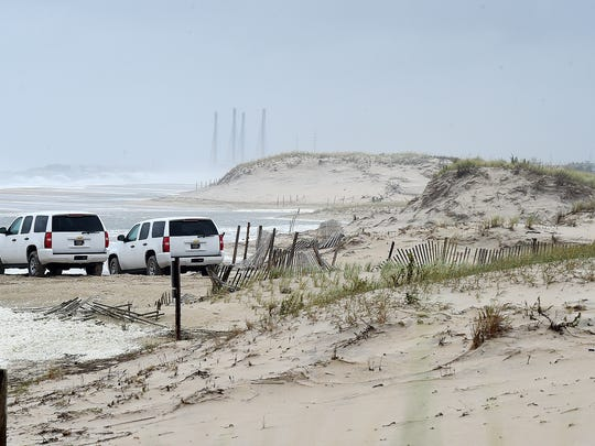 Large waves from Hurricane Jose breached a dune line south of Dewey Beach that resulted in flooding on Coastal Highway.