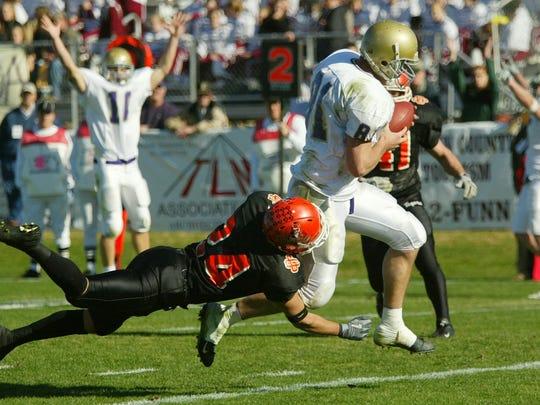 Carroll College's Casey FitzSimmons scores a touchdown
