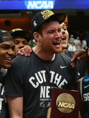 Michigan State's Marvin Clark Jr., Matt Costello and Bryn Forbes celebrate going to the Final Four after today's win over Louisville in Syracuse, N.Y.