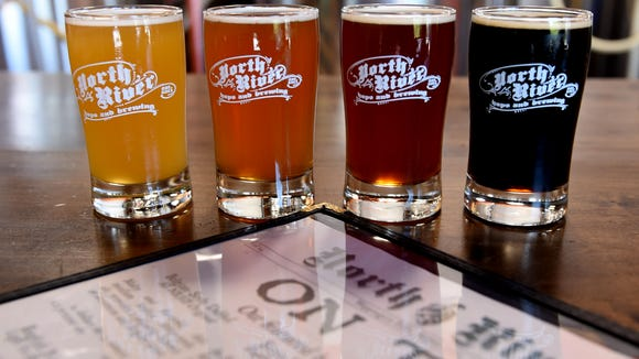 A sampling of beers on tap from North River Hops and Brewing in Wappingers Falls, from left, Tarwe, Paddle Steamer Pale Ale, Belgian-style Dubbel and English Porter.