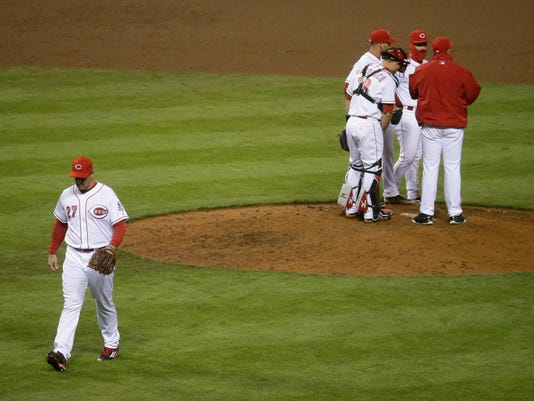 Cincinnati Reds relief pitcher Ross Ohlendorf (27) is relieved after loading the bases in the eighth inning of a baseball game against the Pittsburgh Pirates, Friday, April 8, 2016, in Cincinnati. (AP Photo/John Minchillo)