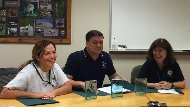 Maria Davidson, left, has been recognized by the U.S. Fish and Wildlife Service (USFWS) for her work in the recovery of the Louisiana Black Bear. Also pictured are David Soileau and Deborah Fuller of the USFWS.