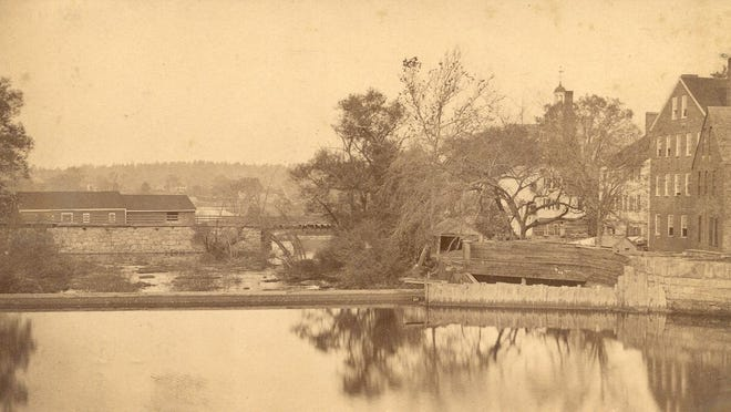 Photo taken from Exeter's Great Bridge before 1874. The two buildings on the far right are the potato starch mill built by Dr. William Perry.