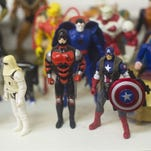 Action figures stand at Fourcorners Comics in Gettysburg.