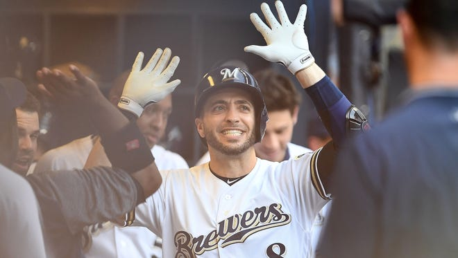 Ryan Braun is greeted in the dugout after his third inning home run.