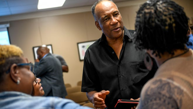 Morris Merriweather speaks with supporters after a board meeting at Jackson-Madison County Board of Education in Jackson, Tenn., Thursday, Aug. 9, 2018.